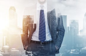 business and people concept - close up of businessman over city buildings background and double exposure effect